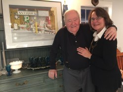 Artist John Brennan exhibits his paintings at Greiser's. With him is his wife, Patricia. — Nancy Doniger Photo