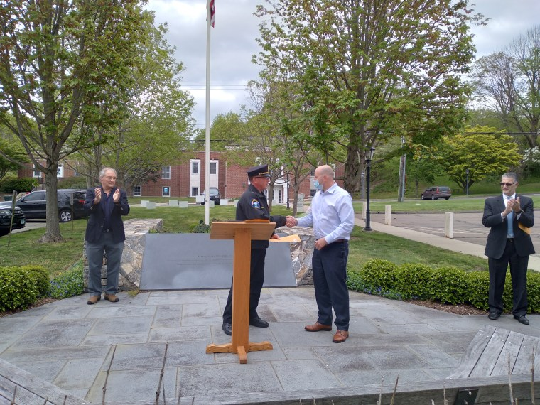 PoliceChief Rich Doyle presents a Civilian Award to Erik Willinger of Newtown.