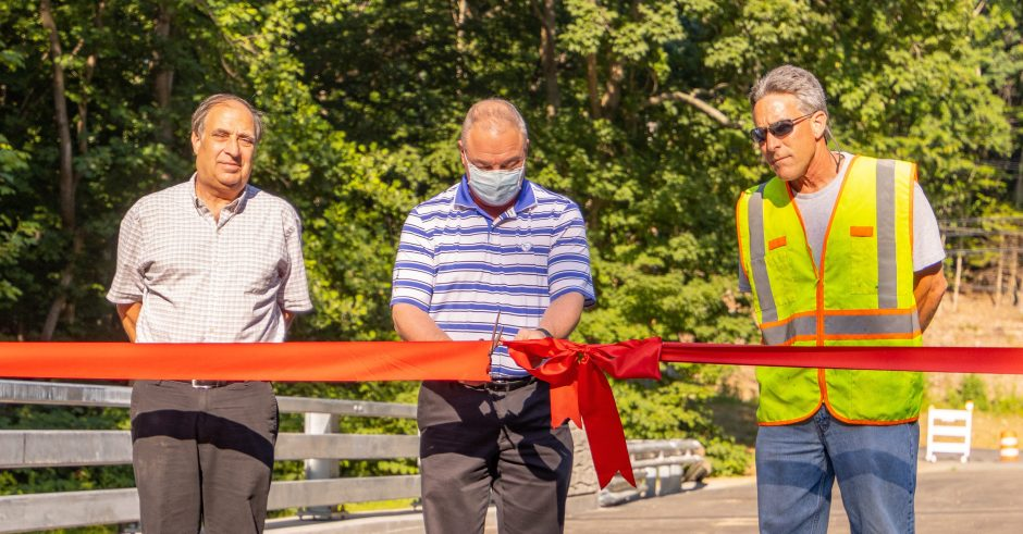 From left to right: Department of Public Works director Ed Nagy, First Selectman Dave Bindelglass, and NJR Construction contractor Nick Mancini cut the ribbon on the bridge on South Park Avenue.