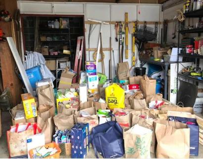Donations fill an entire garage bay at the Blessed Sacrament food pantry.