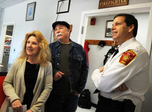 Kurt Steiger, wife Kathy Steiger, of Easton, a victim of a crash during the March 2 nor'easter visited the Lothrop Street fire station in Easton to say thank you to the firefighters and chief Kevin Partridge, for helping her after a branch went through her right leg ,Tuesday, April 17, 2018. (Marc Vasconcellos/The Enterprise)