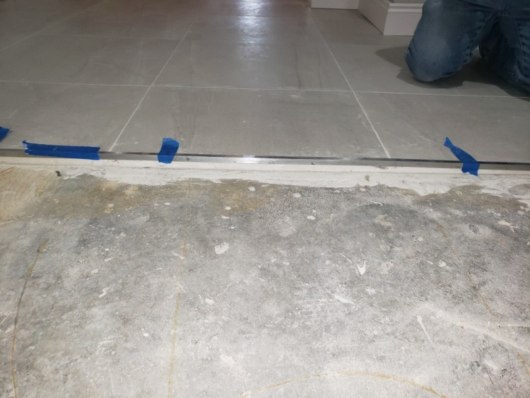 Metal transition from tile to carpet
