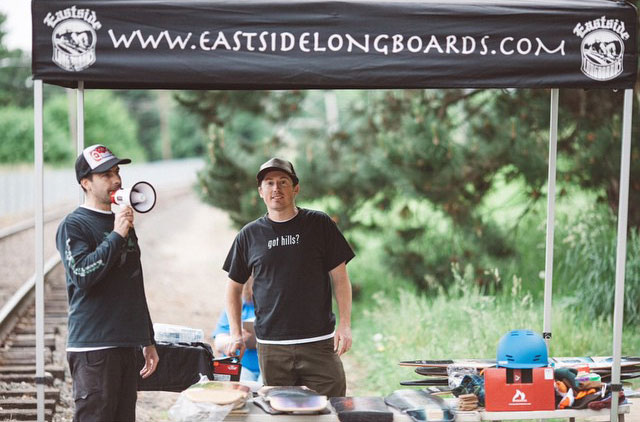 Organizers Josh Burt and Robin McGuirk about to run the raffle near the finish line.  Photo by Kevin Carlton.