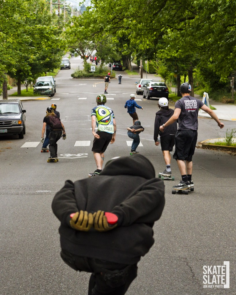 Riders hitting the first hill section as they bomb down threw the Eastside of Portland.
