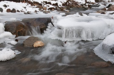 Ice formations seem to float above the flow in Fargo Brook.