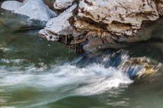 Icicles hang above the flowing current in Huntington Gorge.