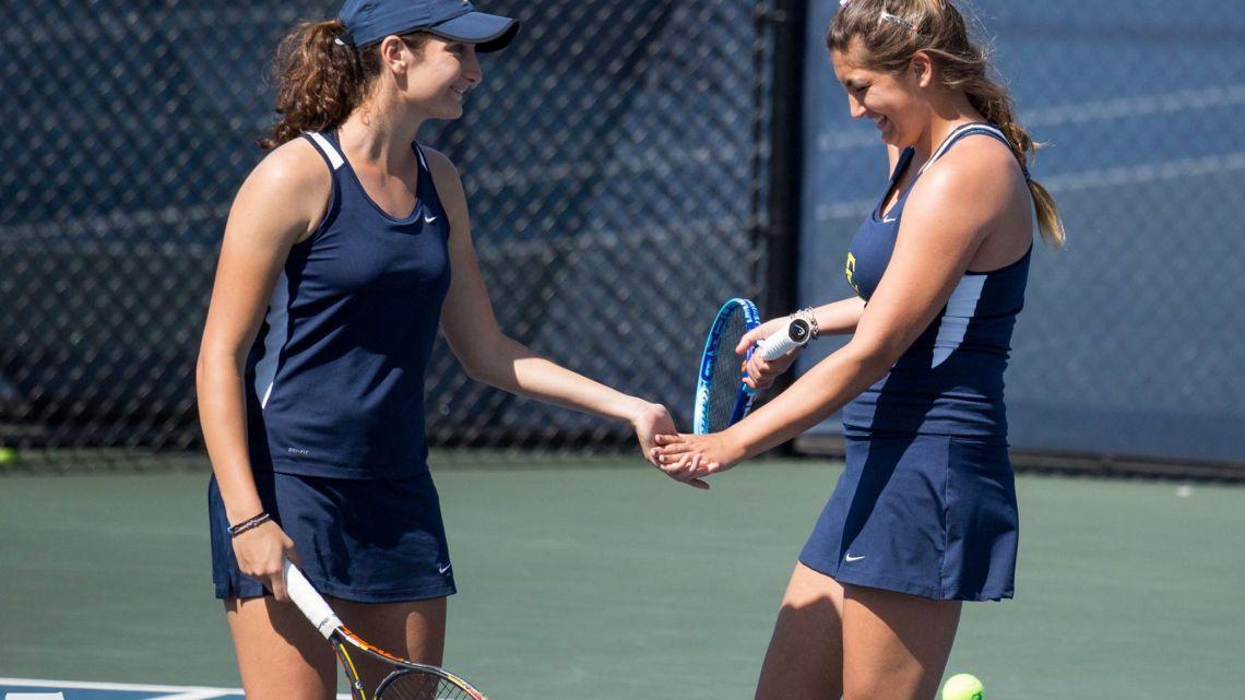 Marina Espana (right) with doubles partner Ioanna Markesini (left) in the match against Wofford. Photo courtesy of etsubucs.com. Photographed by Dakota Hamilton.
