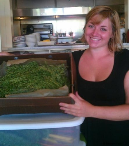 Kathryn delivering herbs to Claire's Restaurant.