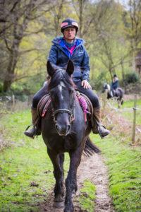 Kath leading a farm ride