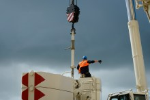 Attaching the crane counterweights before a big lift.