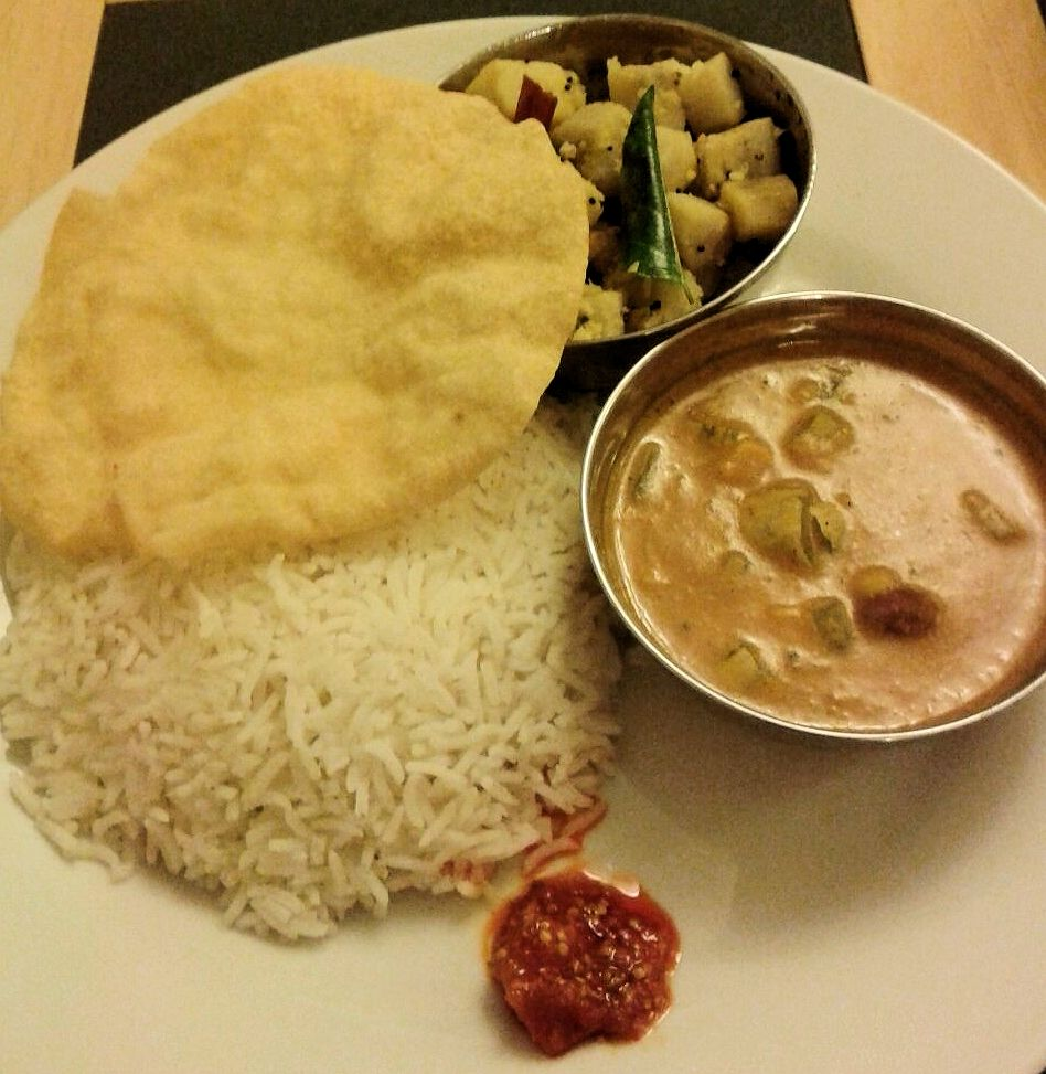 kootu with rice, papad, raw plantain dry curry