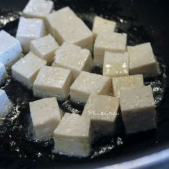 first, pan fry the tofu cubes, gently turning them over every few seconds
