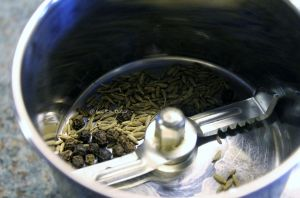 take the cumin and peppercorns in the spice grinder