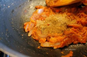 once tomato puree is cooked, add the spice powders, mix
