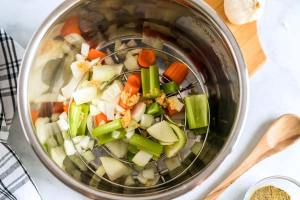 Insert trivet to Instant Pot and add veggies.