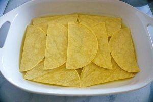 Layer with the halved tortillas.