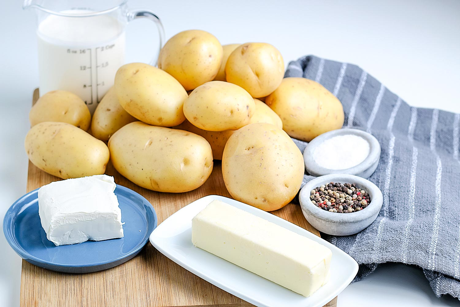 All of the ingredients needed t make creamy mashed potatoes.