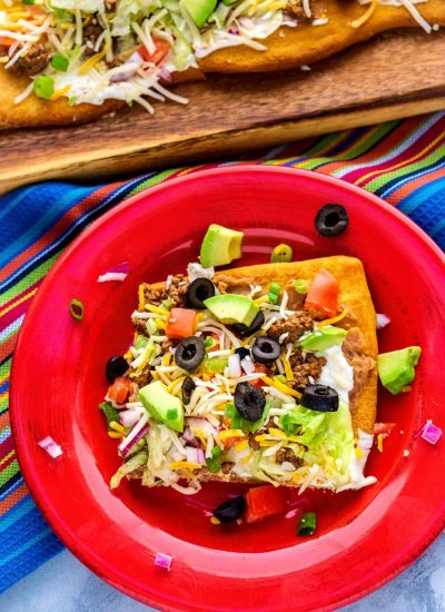 A slice of taco pizza on a plate.