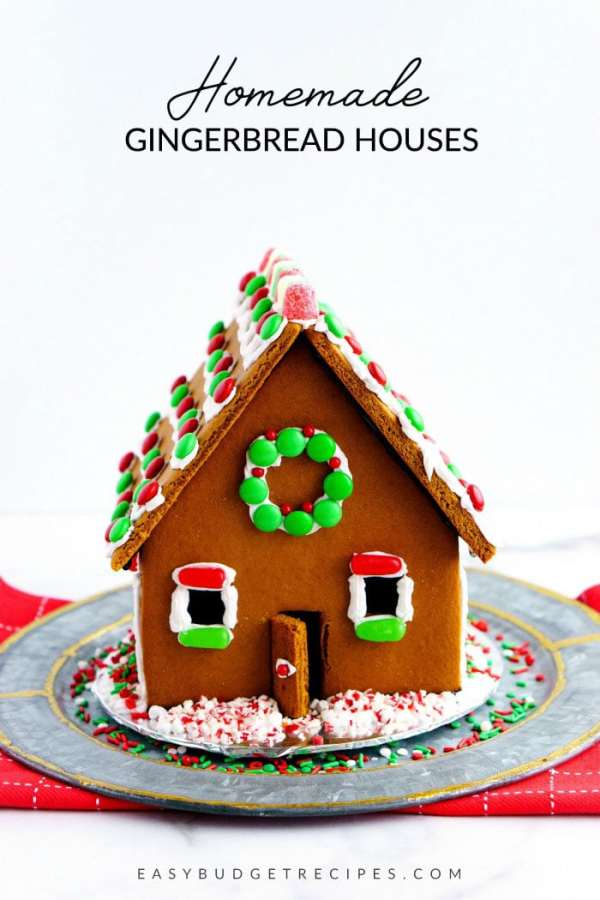 Finished gingerbread house with text overlay for Pinterest.