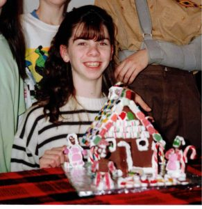Beth when she was a kid making a gingerbread house.