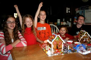 Cousins making gingerbread houses at Beth's house.