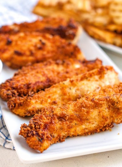 A close up picture of homemade chicken fingers on a platter