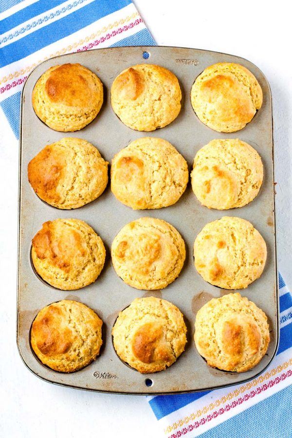 Overhead picture of 12 corn muffins in a muffin tin.