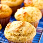 Corn muffins on a wire rack.