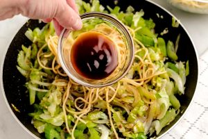Add in the soy sauce and oyster sauce and toss to coat the vegetables and noodles.