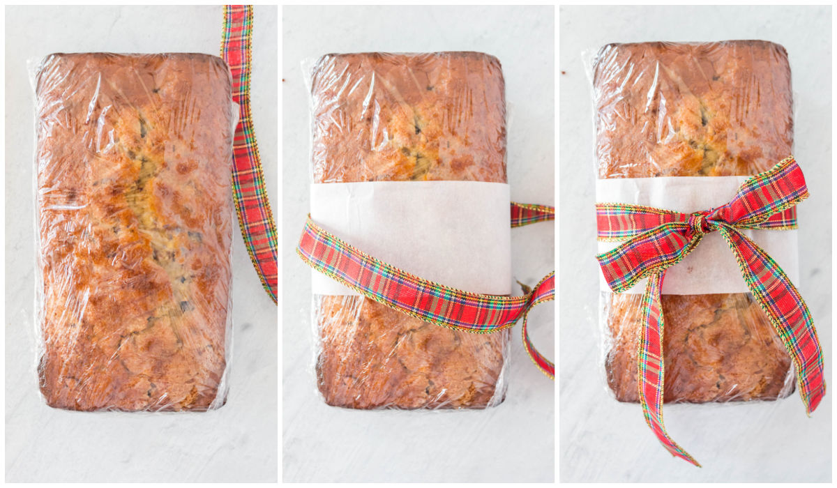 The finished cake mix banana bread being wrapped with plastic wrap and a ribbon for neighbor gifts.
