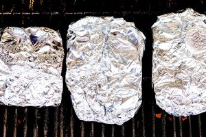 Add the foil packets to the grill and close the grill lid. Cook for 25-30 minutes or until the potatoes are tender.