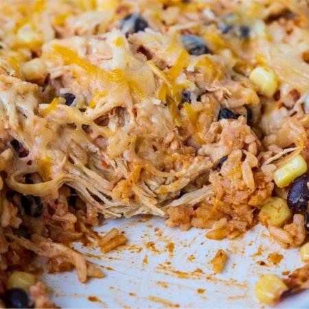 A close up of the taco rice casserole in the casserole dish.