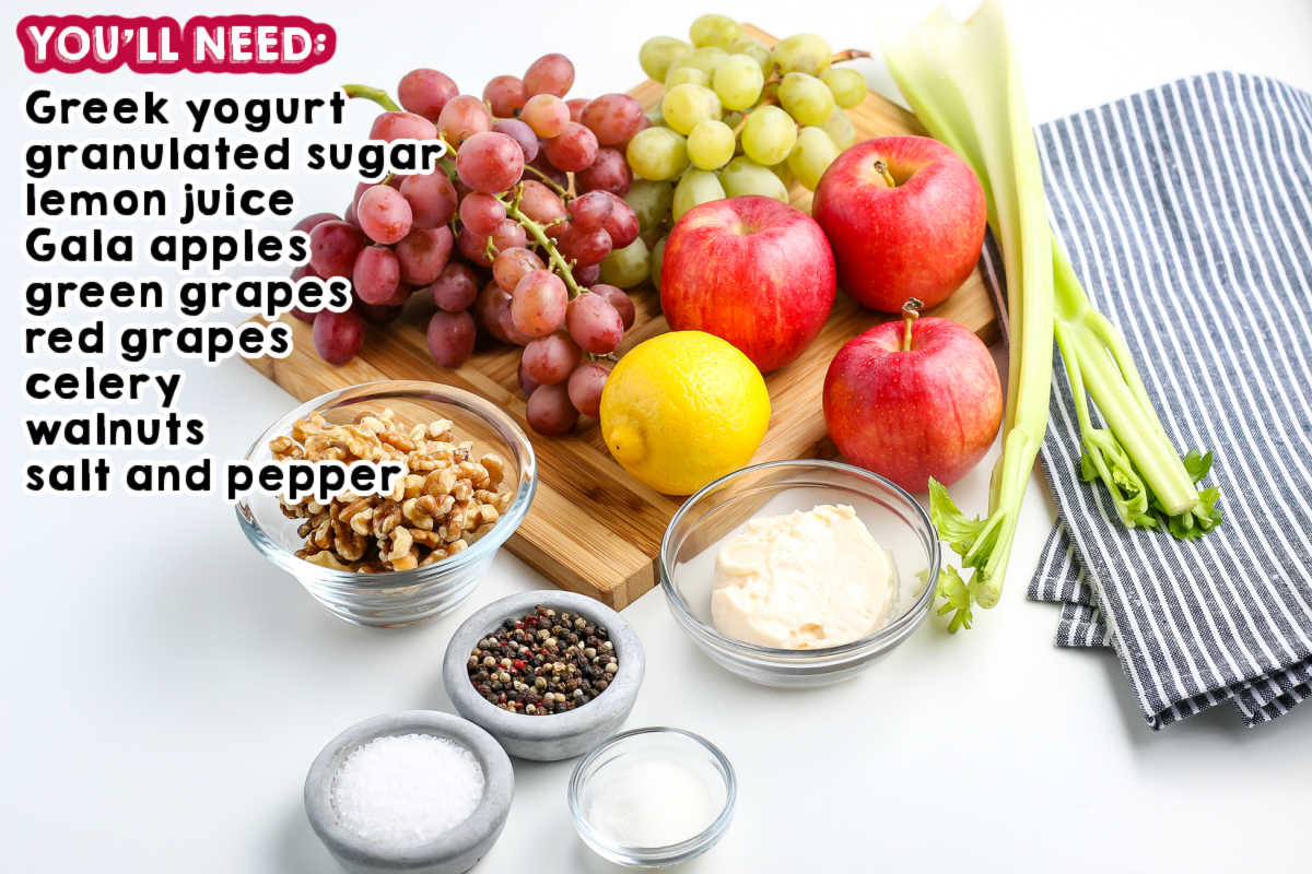All of the ingredients needed to make Waldorf Salad.