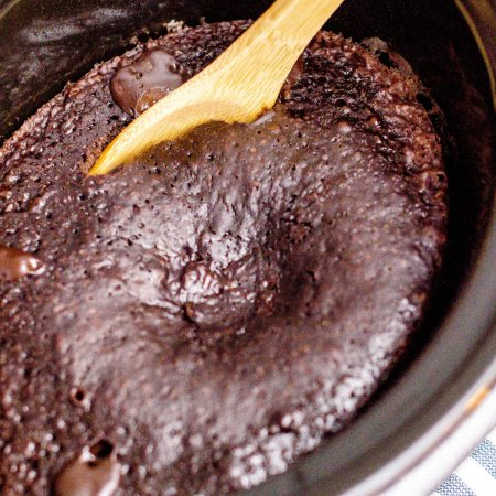 The finished Crockpot Chocolate Lava Cake with a serving spoon in it.