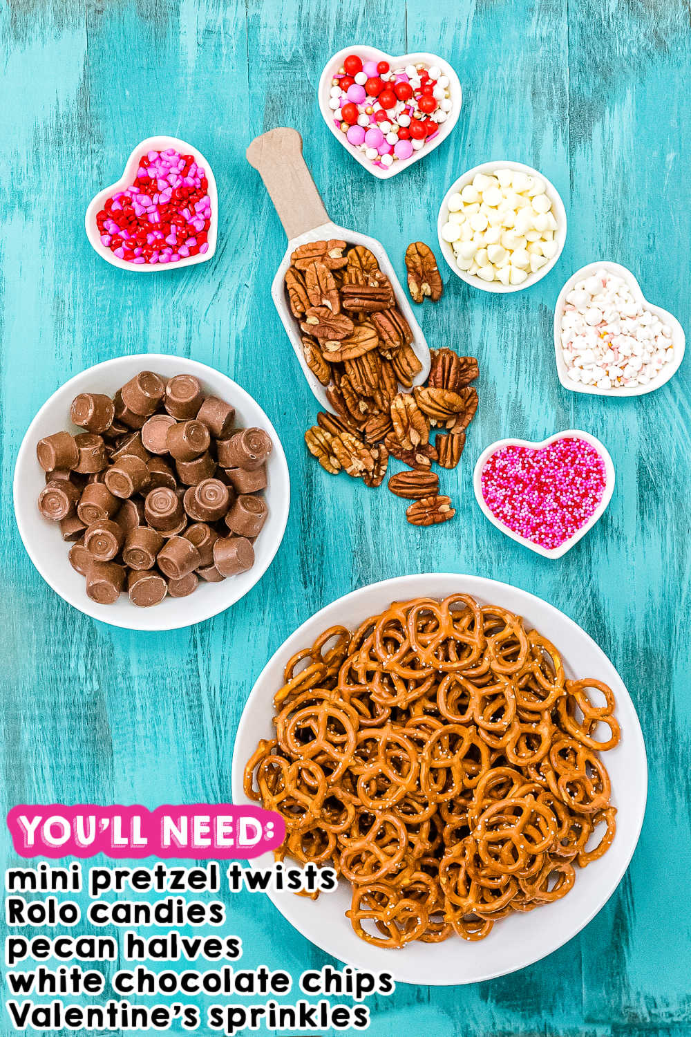 An overhead picture of all of the ingredients needed to make Valentine's Day Rolo Pretzel Turtles.