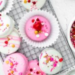 A close up picture of White Chocolate Dipped Oreos decorated for Valentine's Day.