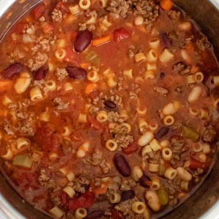 An overhead picture of Olive Garden Pasta e Fagioli Soup.