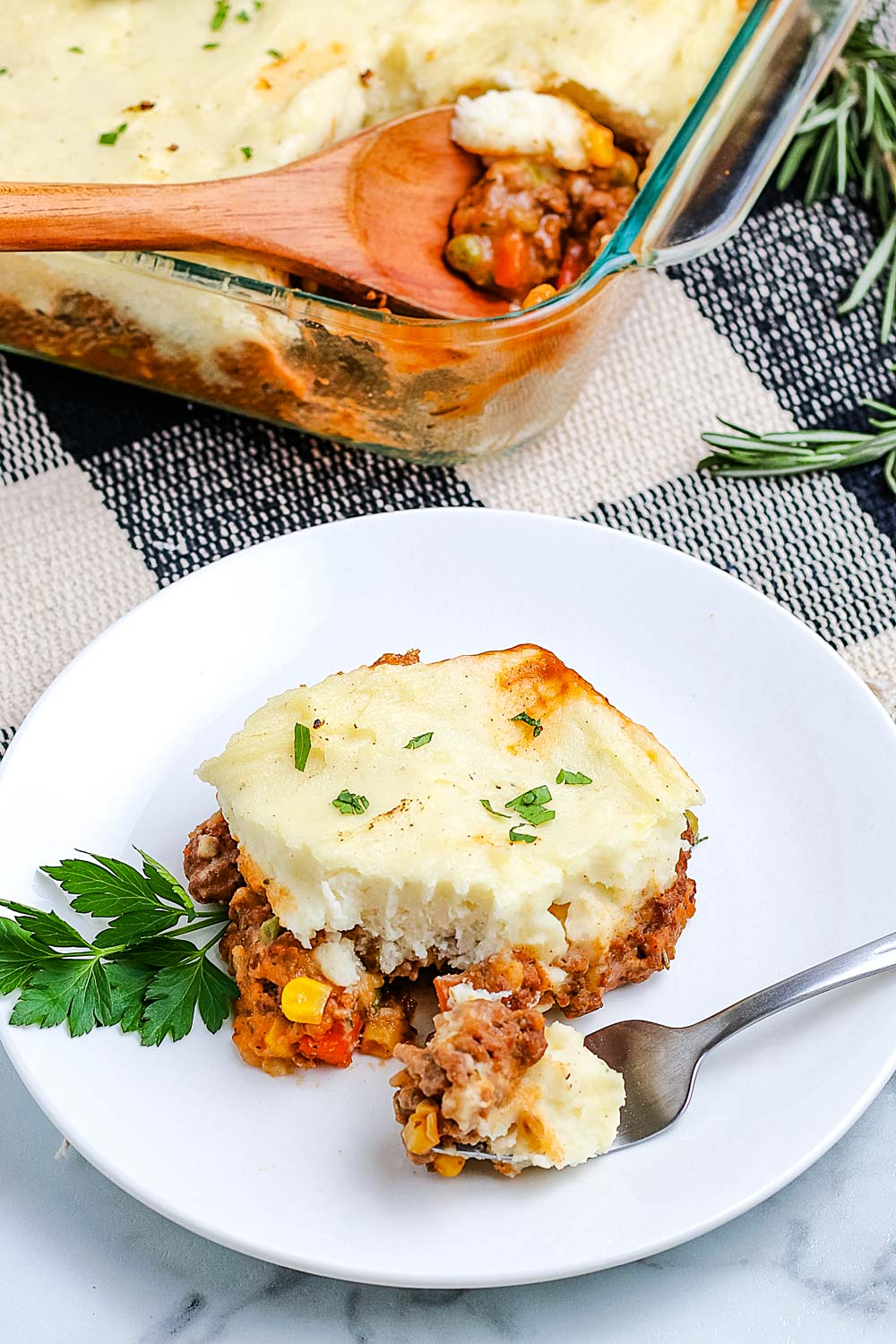 An overhead picture of Shepherd's Pie on a plate and in a casserole dish.