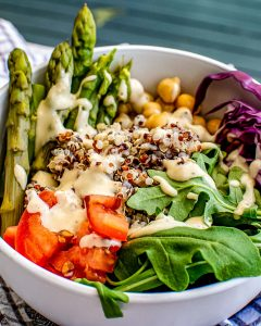 A close up picture of a finished Buddha Bowl with Tahini Dressing.