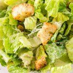 Caesar Salad in a clear glass bowl.