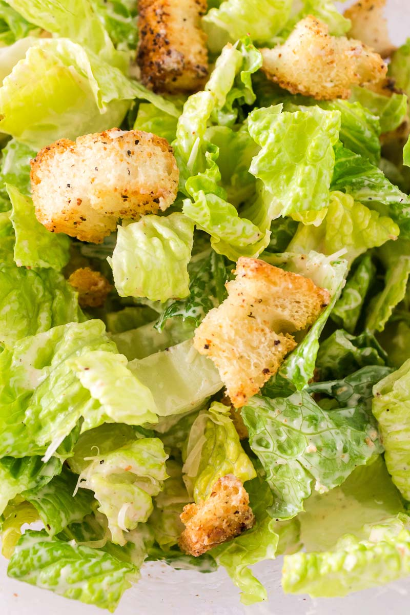 A close up overhead picture of the finished Caesar Salad.