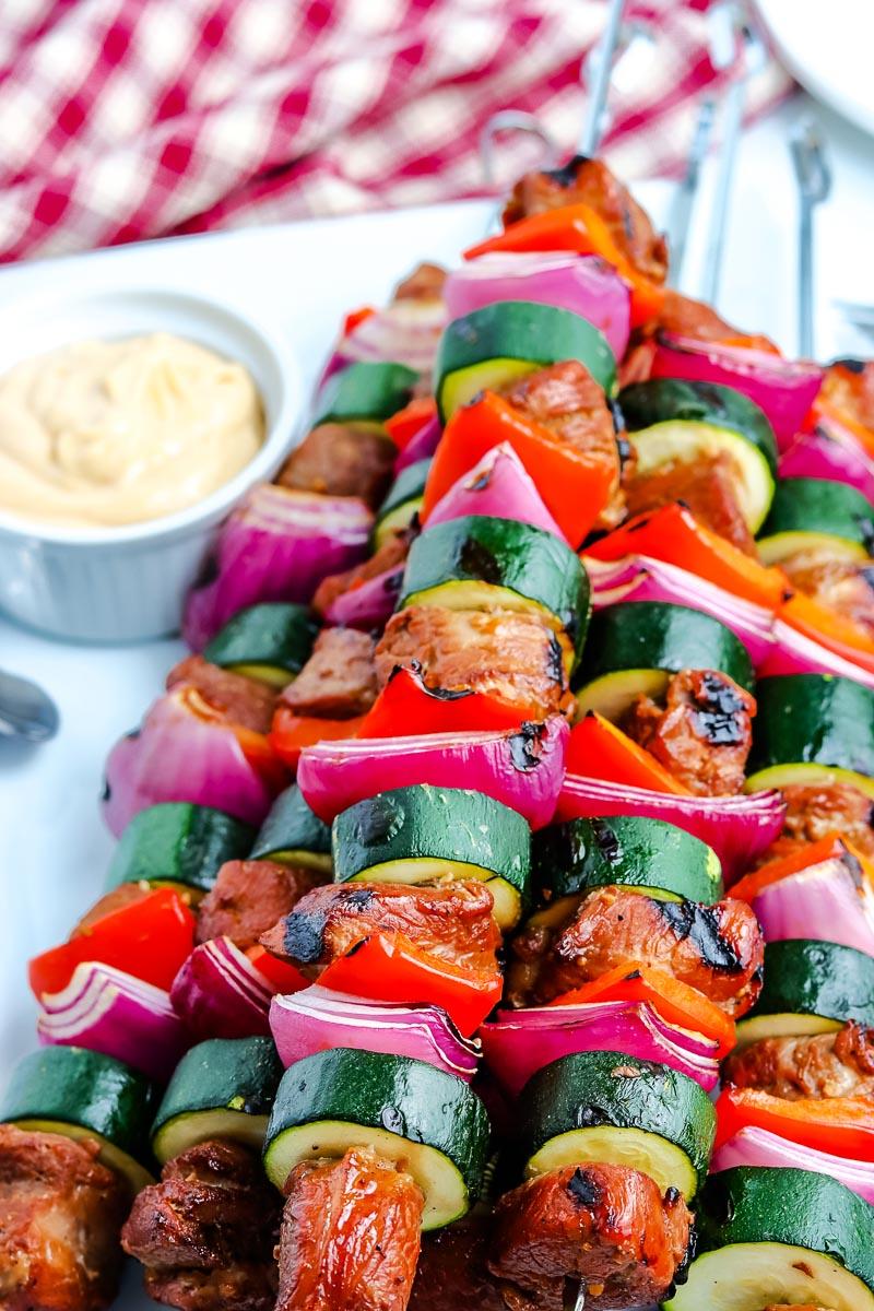 Grilled Pork Kabobs on a white serving platter.
