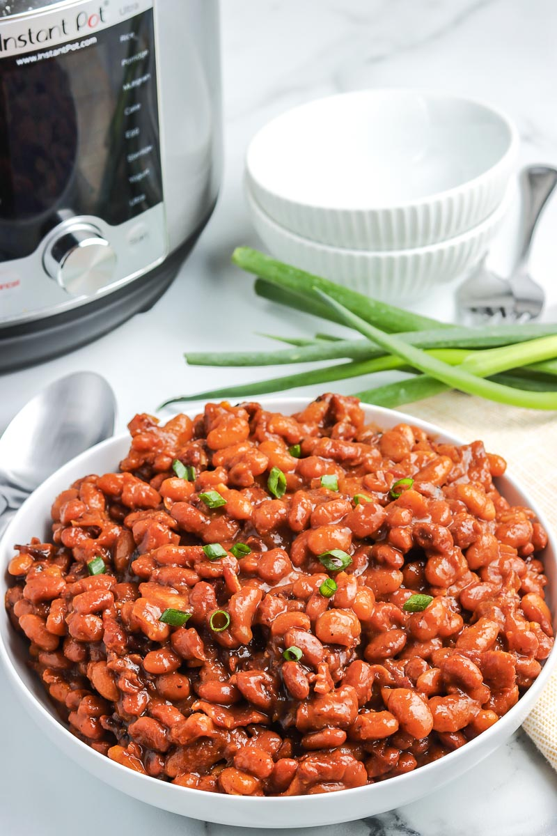 Instant Pot Baked Beans in a white serving bowl.