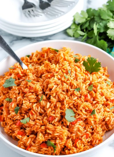 The finished Mexican Rice in a white serving bowl.