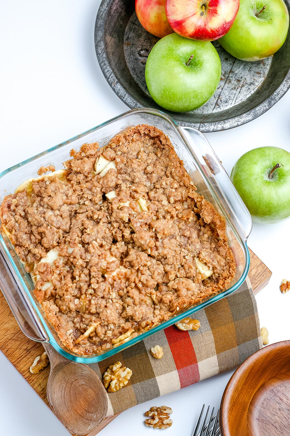 An overhead picture of the finished apple crisp recipe with oats in a baking dish.