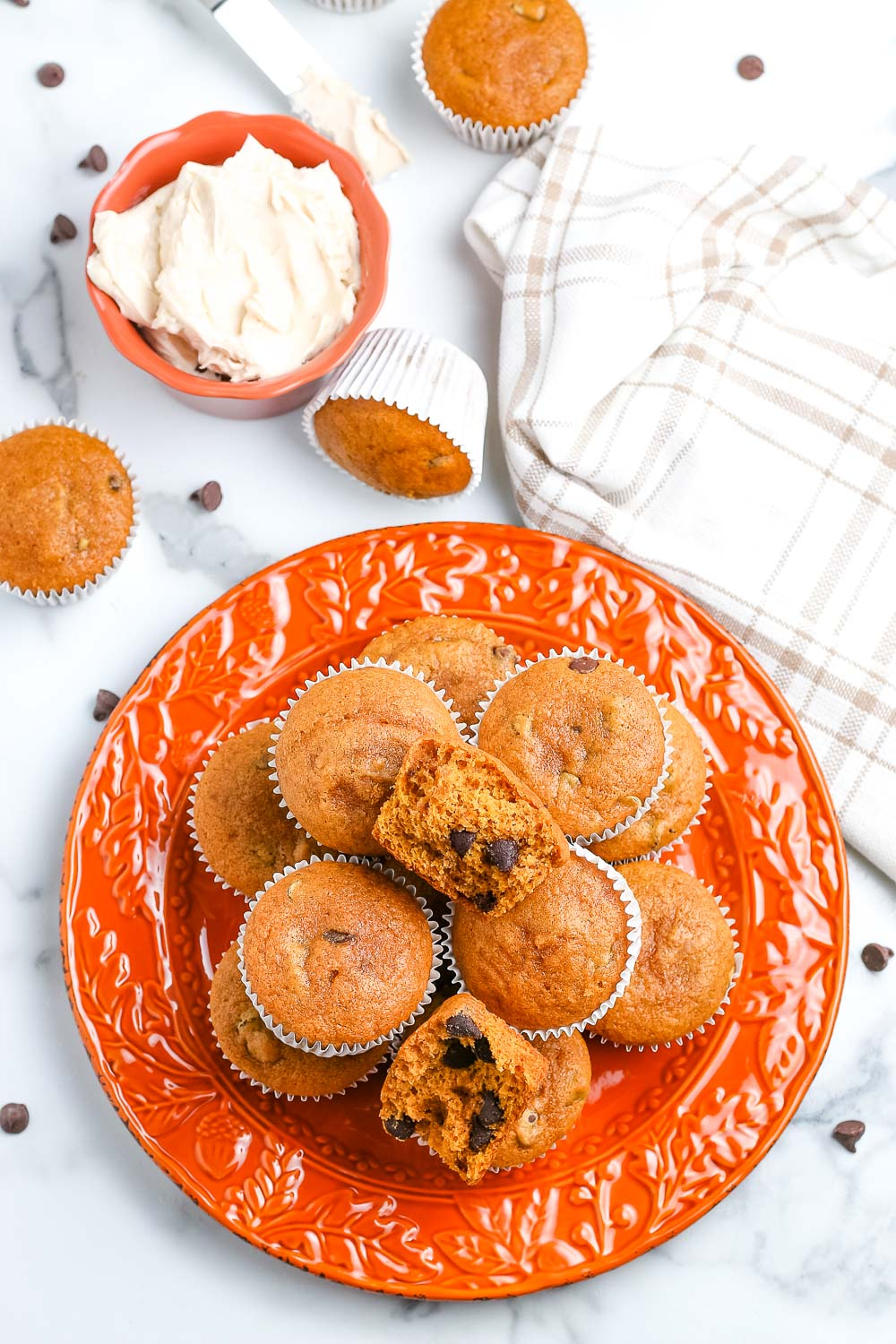 An overhead picture of a plate of the finished Pumpkin Chocolate Chip Muffins.