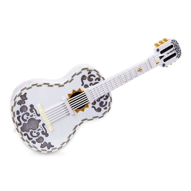 This Disney Coco Interactive Guitar by Mattel plays music when a child presses a button.