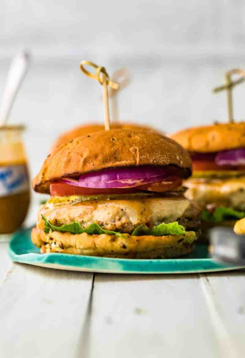 A juicy chicken burger served on a blue plate