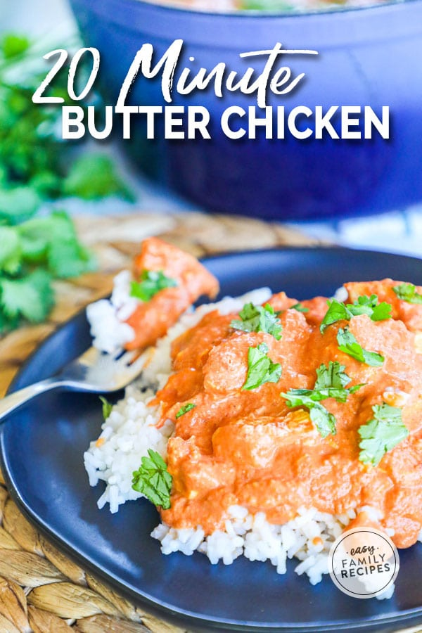 Butter Chicken garnished with cilantro on a plate with a fork