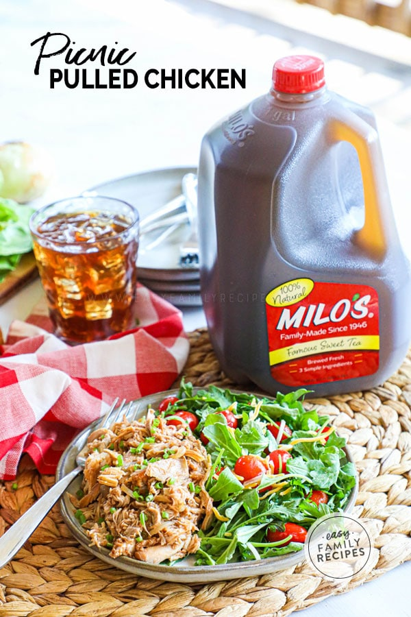Picnic Pulled BBQ Chicken on a plate with salad next to a jug of sweet tea